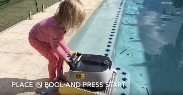 Young girl starting Dolphin X40 robotic cleaner